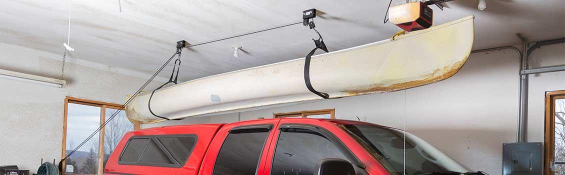 Canoe hoisted above truck
