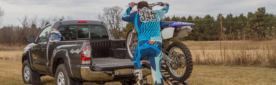 Pushing dirt bike into truck