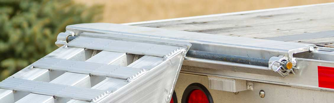 Plate end ramps resting on a trailer