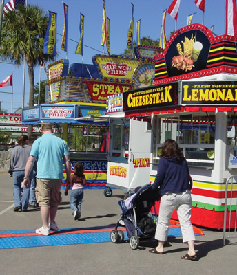Pedestrians crossing cable ramps at an outdoor fair