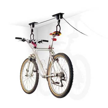 A bicycle raised to the ceiling on a hoist