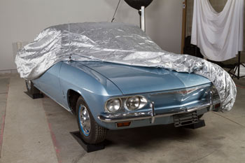 A classic car underneath a cover