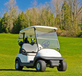 Golf cart parked on grass