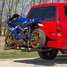 Hitch-mounted motorcycle carrier