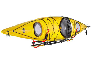 A kayak hanging from wall-mounted rack