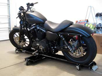 A motorcycle in a garage on a dolly