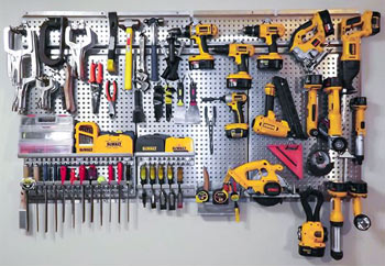 Tools hanging from metal pegboard