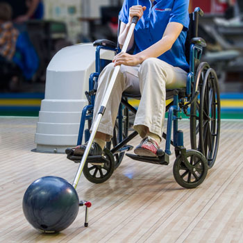 Wheelchair user bowling