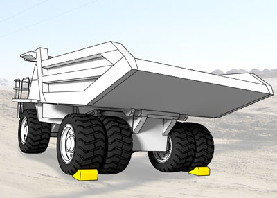 Wheel chocks on each outside rear tire of a truck weighing up to 240 tons