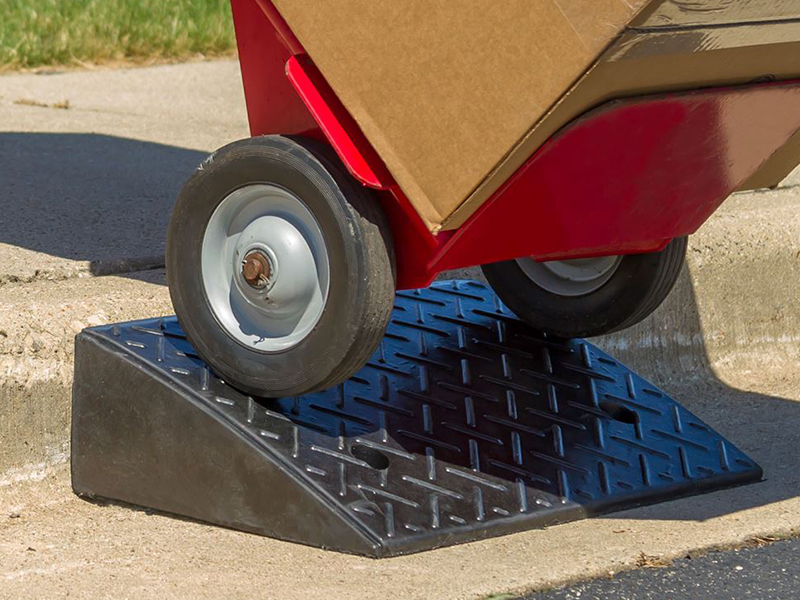 Help vehicles and equipment mount curbs with curb ramps