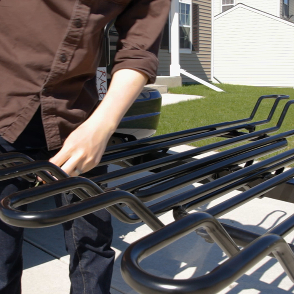 Anchor the bike rack to your vehicle's crossbars