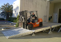 Forklift driving on a custom loading ramp