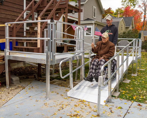 USA veteran using an aluminum modular wheelchair ramp