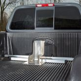 Top view of the Kafe wheel chock holding a motorcycle in the back of a pickup