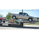 Utilize the top deck of step deck trailer and haul an extra car with our drop de