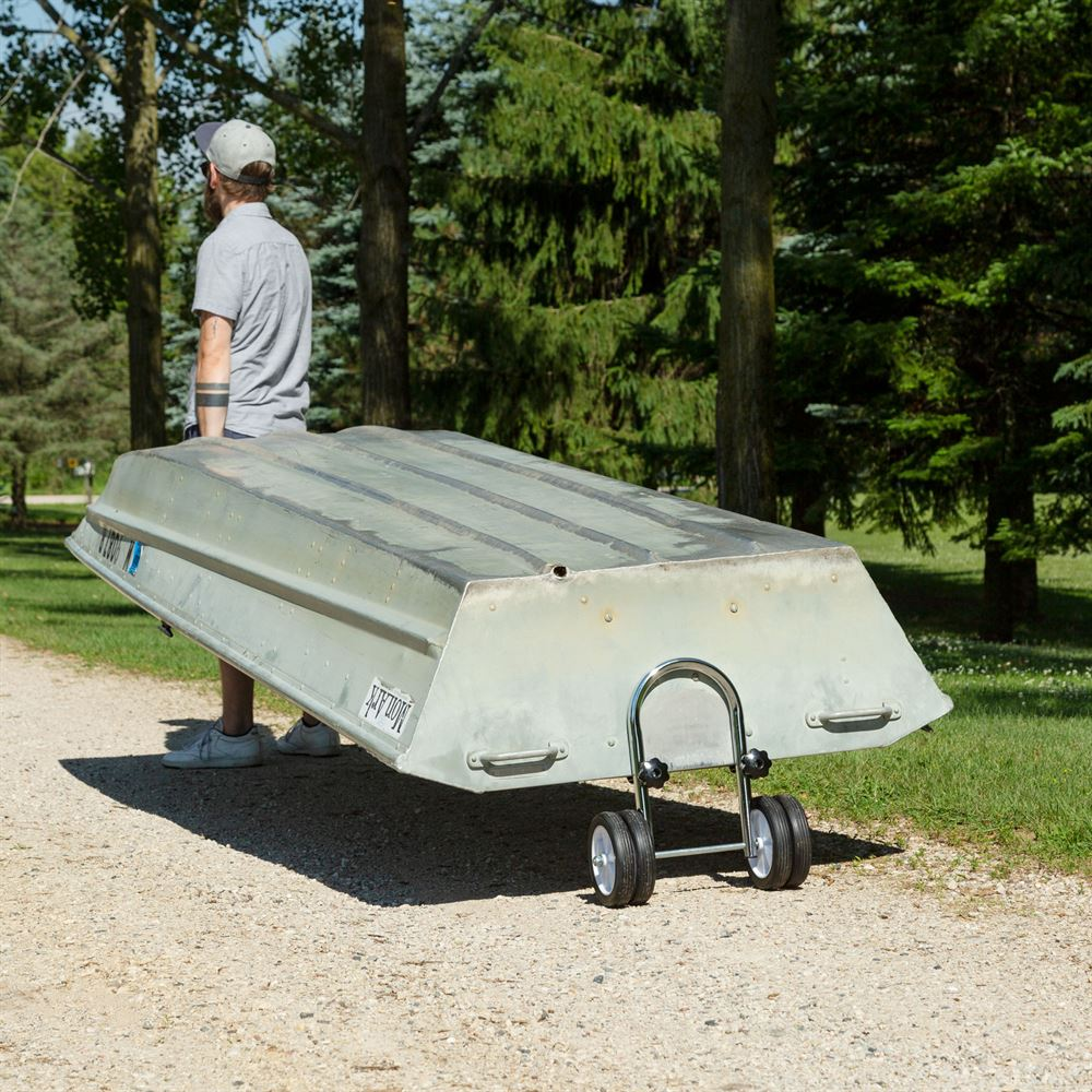 The boat dolly secures to the boat with adjustable knobs