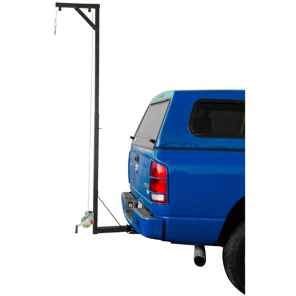 Hitch-mounted snowmobile hoist