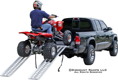 Riding an ATV into a pickup using dual runner ramps