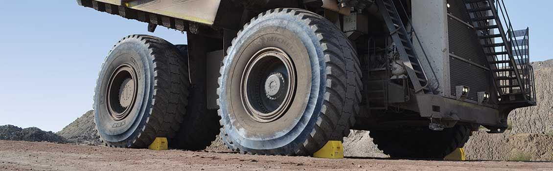 Wheel chocks on large dump truck