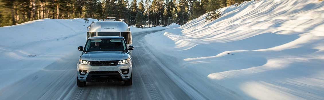 Land Rover towing Airstream in Winter