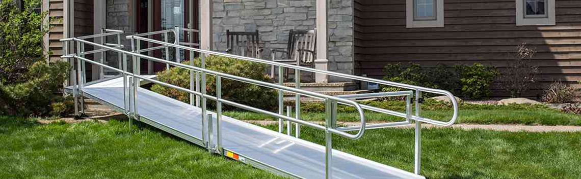 Modular wheelchair ramp in front of a home