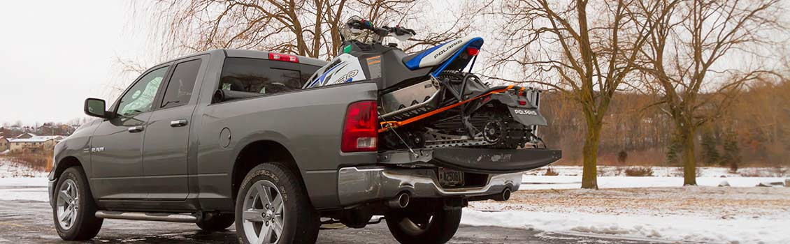 snowmobile loaded in a truck bed