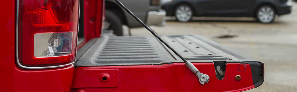 Pickup truck tailgate cable