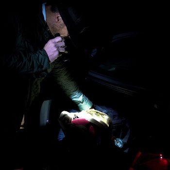 shining flashlight at trunk
