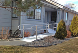 modular wheelchair ramp in front of home