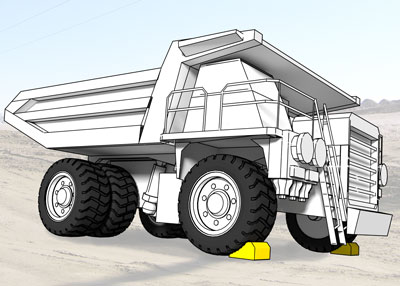 Wheel chocks on each front tire of a truck weighing up to 240 tons