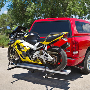 A loaded motorcycle carrier on a pickup