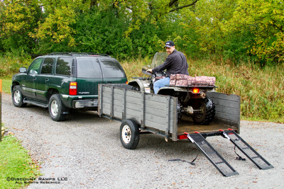 Loading an ATV into a trailer with steel dual runner ramps