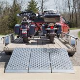 Two motorcycle loaded into a trailer using the Kafe double wheel chock