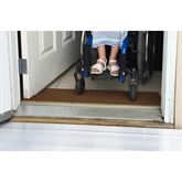 Using a wheelchair over the rubber threshold ramp