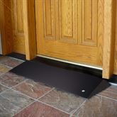 Beveled threshold ramp for wheelchairs and scooters