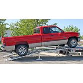 Loading a long bed Dodge Diesel pick up truck onto a step deck trailer with our